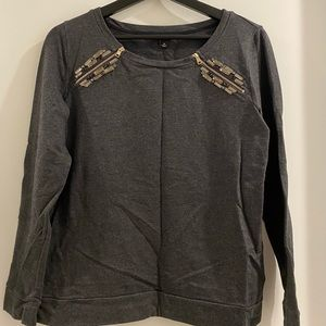 grey top with zipper and jewels on shoulders